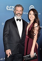 LOS ANGELES, CA - JANUARY 05: Mel Gibson (L) and Rosalind Ross attend Michael Muller's HEAVEN, presented by The Art of Elysium at a private venue on January 5, 2019 in Los Angeles, California.<br /> CAP/ROT/TM<br /> ©TM/ROT/Capital Pictures