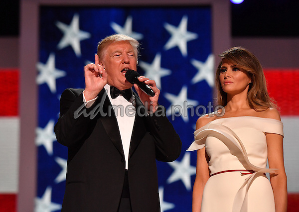 President Donald Trump with First Lady Melania Trump speaks to supporters at the Liberty Ball at the Washington Convention Center on January 20, 2017 in Washington, D.C. Trump will attend a series of balls to cap his Inauguration day. Photo Credit: Kevin Dietsch/CNP/AdMedia
