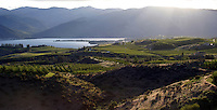 World famous apple orchards and new wine grape vineyards dot the landscape in the Lake Chelan Valley.