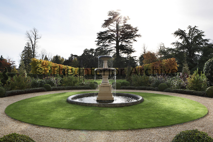 A tiered fountain in one of the gardens at Williamstrip, surrounded by well stocked flowerbeds and an immaculately kept lawn