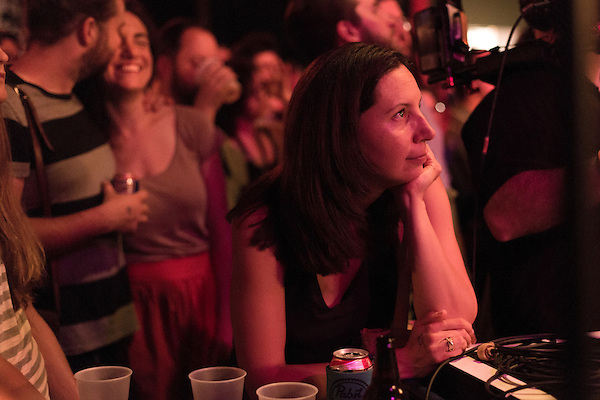 July 25, 2014. Carrboro, North Carolina.<br />  Zoe Kontes, who traveled from Ohio for the festival, watches as The Mountain Goats take the stage on Friday.<br />  Day three of the MERGE 25 festival, celebrating the 25 year history of the independent record label.