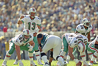 Dan Marino call signals at the line during the final game of the legendary quarterback's career, a 62 to 7 Playoff loss by his Miami Dolphins tot he Jacksonville Jaguars in Alltell Stadium, Jacksonville, FL, January 15, 2000. (Photo by Brian Cleary/www.bcpix.com)
