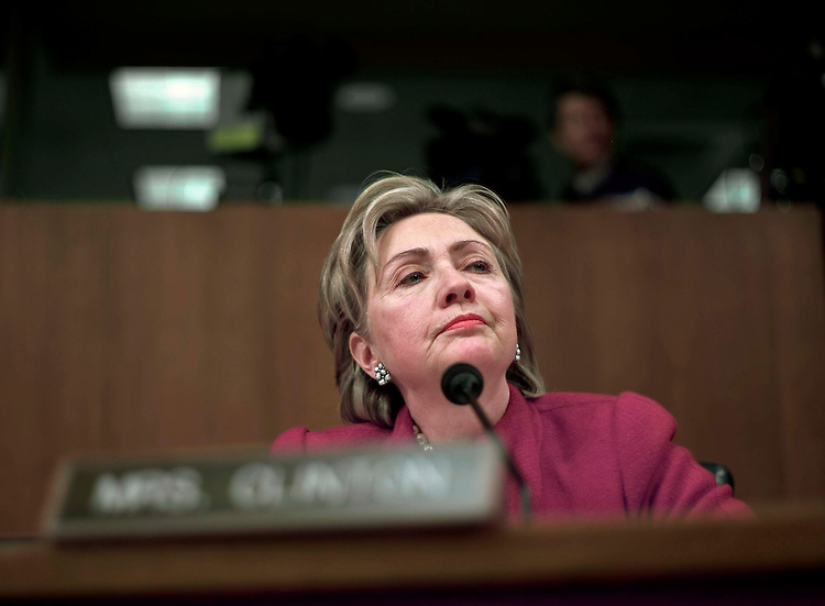 02/06/07--Sen. Hillary rodham Clinton, D-N.Y., during the Senate Armed Services hearing, on the Defense Department budget and fiscal 2007-08 war supplemental request, with Defense Secretary Robert M. Gates and Joint Chiefs Chairman Gen. Peter Pace. Skepticism about President BushÕs plan in Iraq and its impact on military readiness dominated a Senate Armed Services Committee hearing Tuesday that was meant as a discussion of the fiscal 2008 Defense budget. Senators questioned Defense Secretary Robert M. Gates and the chairman of the Joint Chiefs of Staff, Marine Corps Gen. Peter Pace, about how many more than the 21,500 troops the president has said he plans to add in Iraq would actually be needed, for how long and at what cost. Several senators expressed worries that the success of the troop ÒsurgeÓ hinges on Iraqi forces of questionable reliability. And they fretted about the state of the military beyond Iraq. ÒThe heavy deployment of our forces to Iraq has increased the stress on our force, and reduces the ability of our military to train for and react to challenges in other parts of the world if need be,Ó said panel chairman Carl Levin, D-Mich. Congressional Quarterly Photo by Scott J. Ferrell