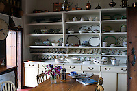 The large dresser in the kitchen houses many dinner services that Detmar and Isabella Blow used for entertaining their friends