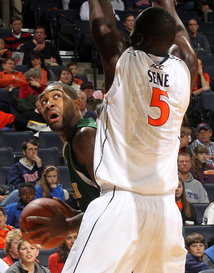 Dec. 20, 2010; Charlottesville, VA, USA; Norfolk State Spartans guard/forward Chris McEachin (35) is defended by Virginia Cavaliers center Assane Sene (5) during the game at the John Paul Jones Arena. Mandatory Credit: Andrew Shurtleff