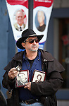 Mark Grills, of Reno, holds photos of his parents Al and Violet Grills, who were both Navy veterans, as he watches the annual Veterans Day parade in Virginia City, Nev., on Monday, Nov. 11, 2013.<br /> Photo by Cathleen Allison