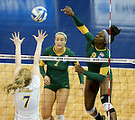 SIOUX FALLS, SD - DECEMBER 8:  Chrisalyn Johnson #9 from Alaska Anchorage gets a kill past Abbie Lynn #7 from Angelo State in the Women's Division II Volleyball Championship Thursday at the Sanford Pentagon in Sioux Falls, SD.  (Photo by Dave Eggen/Inertia)
