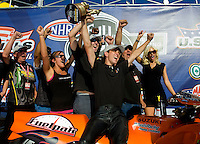 Sept. 6, 2010; Clermont, IN, USA; NHRA pro stock motorcycle rider L.E. Tonglet celebrates after winning the U.S. Nationals at O'Reilly Raceway Park at Indianapolis. Mandatory Credit: Mark J. Rebilas-