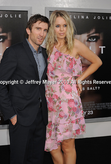 """LOS ANGELES, CA. - July 19: Sharlto Copley and guest arrives at the """"Salt"""" Los Angeles Premiere at Grauman's Chinese Theatre on July 19, 2010 in Hollywood, California."""