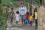Teacher Lodema Dela Cruz Doroteo walks with children in Santa Ines, an indigenous village in the Philippines. A graduate of Harris Memorial College, where she benefited from a scholarship from United Methodist Women, she is the first indigenous school teacher in her village.