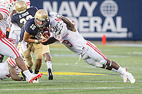 Annapolis, MD - OCT 8, 2016: Navy Midshipmen quarterback Will Worth (15) breaks free of a tackle from Houston Cougars linebacker Matthew Adams (9) during game between Houston and Navy at Navy-Marine Corps Memorial Stadium Annapolis, MD. The Midshipmen upset #6 Houston 46-40. (Photo by Phil Peters/Media Images International)