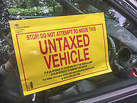 Untaxed vehicle clamped in Osborne Park, Malone, Belfast, N Ireland, 31st May 2019, 201905310526<br /><br />Copyright Image from Victor Patterson, 54 Dorchester Park, <br />Belfast, UK, BT9 6RJ<br /><br />t1: +44 28 9066 1296 (from Rep of Ireland 048 9066 1296)<br />m: +44 7802 353836<br />e: victorpattersonbelfast@gmail.com<br />w: www,victorpatterson.com<br /><br />Please see my Terms and Conditions of Use at https://www.victorpatterson.com/page2<br />It is IMPORTANT that you familiarise yourself with them.<br /><br />Images used on the Internet incur an additional cost and must be visibly watermarked i.e. © Victor Patterson within the body of the image and copyright metadata must not be deleted. Images used on the Internet have a size restriction of 4kbs and are chargeable at rates available at victorpatterson.com.<br /><br />This image is only available for the use of the download recipient i.e. television station, newspaper, magazine, book publisher, etc, and must not be passed on to any third party. It is also downloaded on condition that each and every usage is notified within 7 days to victorpattersonbelfast@gmail.com.<br /><br />The right of Victor Patterson to be identified as the author is asserted in accordance with The Copyright Designs And Patents Act (1988). All moral rights are asserted.