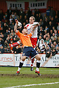 David Bridges of Stevenage Borough and Keith Keane of Luton  go for a header during the  Blue Square Premier match between Stevenage Borough and Luton Town at the Lamex Stadium, Broadhall Way, Stevenage on Saturday 3rd April, 2010..© Kevin Coleman 2010 .