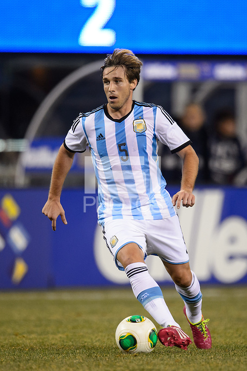 Argentina midfielder Lucas Biglia (5). Argentina and Ecuador played to a 0-0 tie during an international friendly at MetLife Stadium in East Rutherford, NJ, on November 15, 2013.