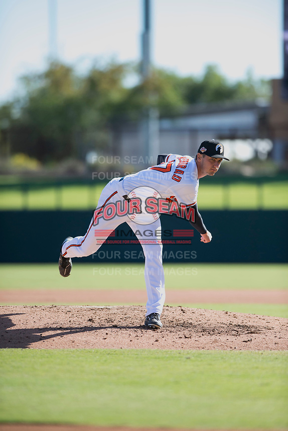 Glendale Desert Dogs relief pitcher Tanner Chleborad (37), of the Baltimore Orioles organization, follows through on his delivery during an Arizona Fall League game against the Mesa Solar Sox at Camelback Ranch on November 12, 2018 in Glendale, Arizona. Glendale defeated Mesa 4-2. (Zachary Lucy/Four Seam Images)