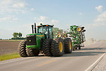 2007 John Deere 9520 tractor on the highway with folded-up cultivator, Macooupin Co., Illinois
