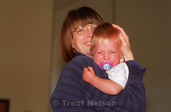 Laura Nelson holds Noah Nelson, who is crying, scared of Santa<br />