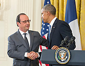 United States President Barack Obama, right, and President Francois Hollande of France, left, shake hands as they conduct a joint press conference in the East Room of the White House in Washington, DC on Tuesday, November 24, 2015. The leaders agreed on the need to contain ISIL.<br /> Credit: Ron Sachs / CNP