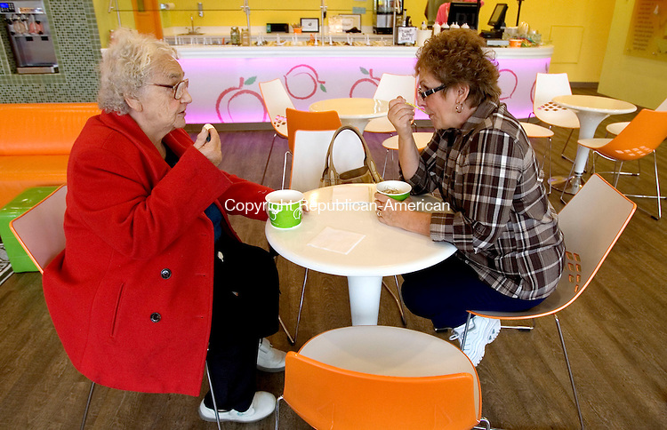 WATERTOWN, CT. 26 October 2012-102612SV15-From left, Ann Summa, 89, of Wolcott, and her daughter Betty Marucci of Waterbury enjoy frozen yogurt at Peachwave in Watertown Friday.  .Steven Valenti Republican-American