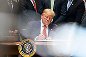 United States President Donald J. Trump signs two executive orders on transparency in federal guidance and enforcement in the Roosevelt Room of the White House in Washington, DC, USA, 09 October 2019. Trump used the opportunity to speak about his impeachment inquiry, as well as Turkey's move into Syria.<br /> Credit: Jim LoScalzo / Pool via CNP