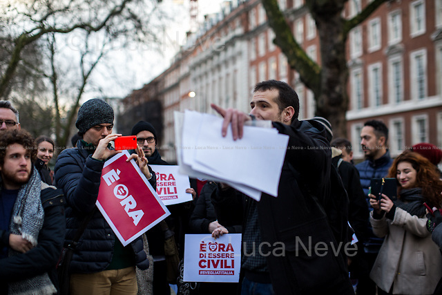 London, 23/01/2016. Today, London's Italian people and members of the public held a demonstration outside the Italian Embassy in London to call for ending &quot;the violation of human rights LGBT people&quot;. Similar demonstrations were held in more than hundred cities across Italy supporting the ddl - Decree-Law - Cirinn&agrave; (Family name of the Democratic Party PD Senator who presented the Law about same-sex unions) which supports the recognisement of the Civil Unions as specific social formations. The two partners can declare their union to the State Official in front of two witnesses (For more information please click here: http://bit.ly/1PMnaAB - source Wikipedia.org). From the organisers Facebook page: &lt;&lt; [&hellip;] We live in the UK, where our sentimental lives and our parenthood abilities are fully recognised under the law. Italian LGBT people cannot tell the same: in not recognising any form of same-sex couple and in denying the rights of children of same-sex couples, Italy wounds and humiliates the lives of Italian LGBT+ people. As Italian LGBT+ citizens and allies, we are outraged by this. Italy must end this violation of human rights, for which it has been condemned by the European Court of Human Rights. Further delays in the legal recognition of same-sex couples will only strengthen the apartheid. Lesbian, gay, bisexual and trans* people living in Italy cannot wait any longer: their lives are at stake. [&hellip;]&gt;&gt;.<br /> <br /> For more information please click here: http://on.fb.me/1Zz4WYG &amp; http://bit.ly/1SdizgJ<br /> <br /> Article from the Guardian newspaper about this news: http://bit.ly/1OH000W