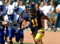 Sean Cattouse of California runs the ball after intercepted it during the game against Presbyterian at AT&T Park in San Francisco on September 17th, 2011.  California defeated Presbyterian, 63-12.
