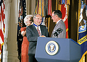 United States President George H.W. Bush and first lady Barbara Bush present the Presidential Medal of Freedom to US Secretary of Defense Dick Cheney during a ceremony in the East Room of the White House in Washington, DC on July 3, 1991. Secretary Cheney is is being honored for his efforts to ensure the success of Operation Desert Shield / Operation Desert Storm and the liberation of Kuwait.<br /> Credit: Ron Sachs / CNP