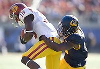 Kameron Jackson of California tackles Nelson Agholor of USC during NCAA football game at Memorial Stadium in Berkeley, California on November 9th, 2013.   USC defeated California, 62-28.