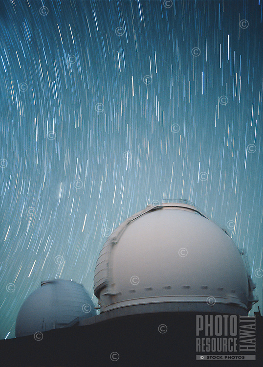 The world three greatest telescopes captured in a single photograph:  The twin telescopes of the W.M. Keck Observatory in the foreground, and the Hubble Space Telescope orbiting overhead (diagonal streak in the sky, top right of the image).