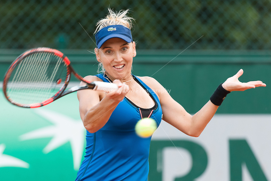 May 24, 2015: Elena Vesnina (RUS) in action in a 1st round match against  Kirsten Flipkens (BEL) on day one of the 2015 French Open tennis tournament at Roland Garros in Paris, France. Sydney Low/AsteriskImages