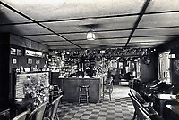 BNPS.co.uk (01202 558833)<br /> Pic: Suzanne Holwell/BNPS<br /> <br /> The ceiling above the bar in 1951. <br /> <br /> Sections of a torn-down pub ceiling which are covered in 250 signatures from World War Two heroes have been salvaged and turned into a memorial.<br /> <br /> The merry airmen left their mark during raucous evenings at the George and Dragon in the village of Clyst St George in Devon.<br /> <br /> Many of the brave men who signed or drew on the wood ceiling perished in the war in the skies with the Luftwaffe.<br /> <br /> One of them, Sergeant Albert Stilin, of 257 Squadron, was killed aged 21 when he crashed his Hurricane into this pub's roof on September 30, 1942. Another airman later put the initials 'RIP' put after his name.<br /> <br /> The ceiling was taken down in 1975 and half of it was destroyed. <br /> <br /> Robin and Suzannah Holwell recovered the surviving planks from a RAFA association store room in 2009 and have carried out a decade-long preservation project, putting the sections in frames and researching the men behind signatures.