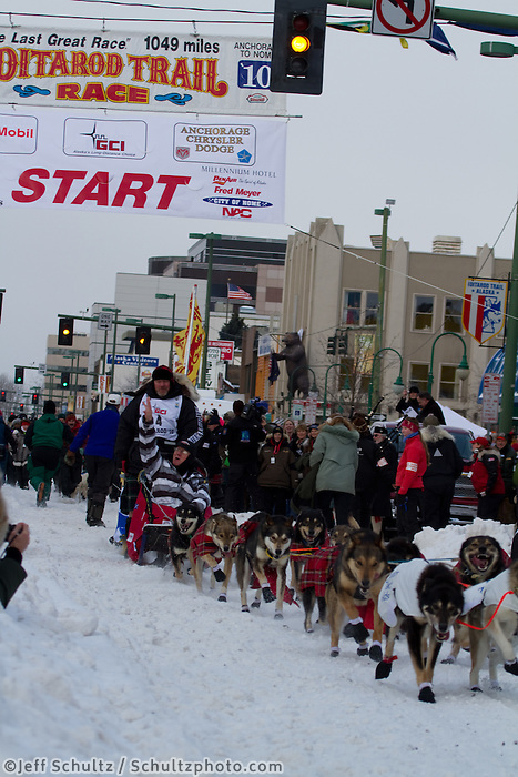 2010 Iditarod Ceremonial Start in Anchorage Alaska musher # 4 WATTIE McDONALD with Iditarider JULIA ROLES