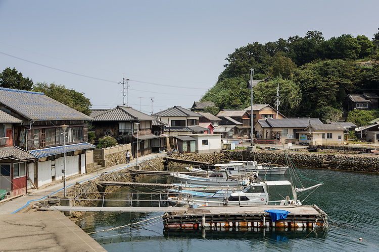 Aoshima, Ehime prefecture, September 4 2015 -  Aoshima island's fishing pier.<br /> Aoshima (Ao island) is one of the several &laquo; cat islands &raquo; in Japan. Due to the decreasing of its poluation, the island now host about 6 times more cats than residents.