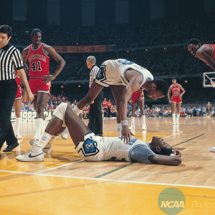 27 MAR 1982:  Georgetown forward Eric Smith (32) checks on center Pat Ewing (33) and Louisville forward/center Wiley Brown (41) looks on during the NCAA Men's National Basketball Final Four semifinal game held in New Orleans, LA, at the Superdome. Georgetown defeated Louisville 50-46 to meet North Carolina for the championship. Rich Clarkson/NCAA PhotosSI CD 0025-19