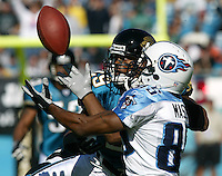 Tennessee Titans receiver Derrick Mason (#85) and Jacksonville Jaguars defender Jason Craft battle for a possession of a pass  during the first quarter of a  game  in Jacksonville, FL on Sunday, December 22, 2002.  Tennessee won the game 28 to 10. (Photo by Brian Cleary/www.bcpix.com)