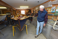 NWA Democrat-Gazette/FLIP PUTTHOFF <br /> Warren Wilkey shows a finished McKenzie drift boat he built. He will use the wooden boat for float fishing, mainly    April 20 2018   on tailwater streams for trout.