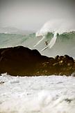 USA, Hawaii, Oahu, surfer riding on a wave at Waimea Bay