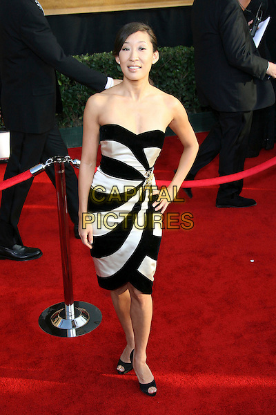 SANDRA OH.12th Annual Screen Actors Guild Awards (SAG) held at the Shrine Auditorium, Los Angeles, California, USA..January 29th, 2006.Photo: Zach Lipp/AdMedia/Capital Pictures.Ref: ZL/ADM.full length hand on hip black white strapless dress stripes striped .ww.capitalpictures.com.sales@capitalpictures.com.© Capital Pictures.