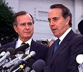 United States President-elect George H.W. Bush and U.S. Senate Minority Leader Bob Dole (Republican of Kansas) meet reporters after their luncheon meeting in the Old Executive Office Building in Washington, DC on November 28, 1988..Credit: Ron Sachs
