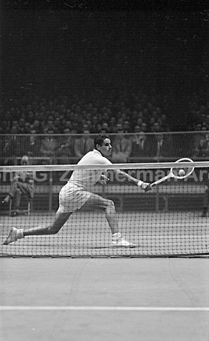 American tennis player Pancho Gonzales in action vs Australian Lew Hoad, Madison Square Garden, 2/58. Photograph by John G. Zimmerman