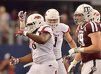 STAFF PHOTO BEN GOFF  @NWABenGoff -- 09/27/14 Arkansas linebacker Brooks Ellis, right, and nose guard Bijhon Jackson celebrate after forcing a Texas A&M fourth down during the first quarter of the Southwest Classic at AT&T Stadium in Arlington, Texas on Saturday September 27, 2014.