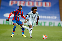 7th July 2020; Selhurst Park, London, England; English Premier League Football, Crystal Palace versus Chelsea; Willian of Chelsea breaks past Wilfried Zaha of Crystal Palace