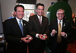 From left, Lt. Gov. Brian Krolicki, Gov. Brian Sandoval and Wells Fargo Regional President Kirk V. Clausen hold the first three medallions minted in a ceremony marking the beginning of production of the second design in a four-part series of Sesquicentennial medallions at the Nevada State Museum, in Carson City, Nev., on Wednesday, Feb. 26, 2014. <br /> Photo by Cathleen Allison/Nevada Photo Source