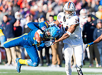 Annapolis, MD - DEC 28, 2017: Navy Midshipmen safety Sean Williams (6) intercepts a pass intended for Virginia Cavaliers wide receiver Andre Levrone (14) during game between Virginia and Navy at the Military Bowl presented by Northrop Grunman at Navy-Marine Corps Memorial Stadium Annapolis, MD. (Photo by Phil Peters/Media Images International)