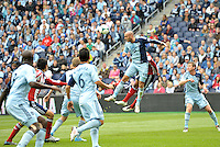 Aurelien Collin (78) defender Sporting KC  clears bthe ball from a corner..Sporting Kansas City defeated Chivas USA 4-0 at Sporting Park, Kansas City, Kansas.