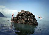 REPUBLIC OF GEORGIA, man jumping from a large rock into the Black Sea, Batumi