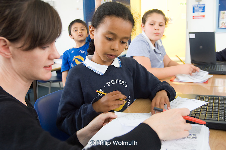 Teacher Rachel Poulton runs an after-school homework club for Year 3 and 4 pupils at St.Peter's C of E Primary School, Paddington, London.