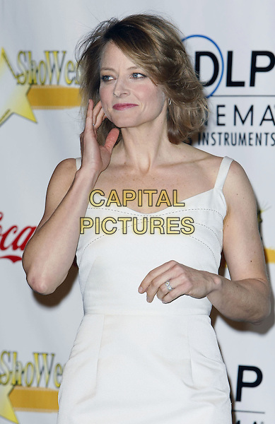 JODIE FOSTER.2008 ShoWest Awards Ceremony held at the Paris Las Vegas Hotel. ShoWest is the official convention of the National Association of Theatre Owners, Las Vegas, Nevada, USA,.13 March 2008.half length white dress hand touching face.CAP/ADM/MJT.©MJT/Admedia/Capital Pictures