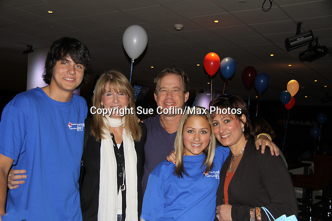Mick Hazen and mom Julie and Allie Gorenc & dad Jimmy & mom Robinat The Seventh Annual Daytime Stars and Strikes benefitting The American Cancer Society hosted by Elizabeth Keifer and Jerry VerDorn with actors from One Life To Live, All My Children, As The World Turns and Guiding Light on October 9, 2010 in New York City, New York. (Photo by Sue Coflin/Max Photos)