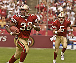 San Francisco 49ers running back Kevan Barlow (32) finds an open spot to run on Sunday, September 15, 2002, in San Francisco, California. The Broncos defeated the 49ers 24-14.